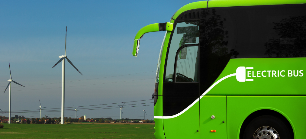 GREEN ELECTRIC BUS & WIND FARM TURBINES.png