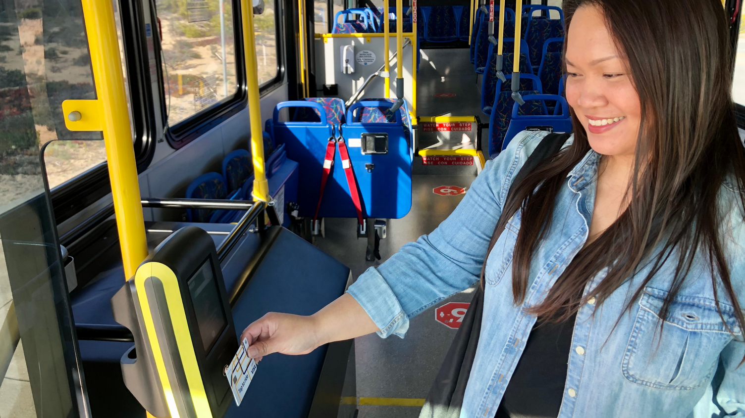 Rider onboard Monterey Salinas Transit bus using the new contactless payment system