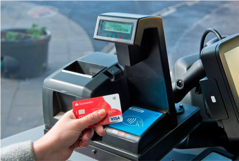 Image of card tapping on payment system